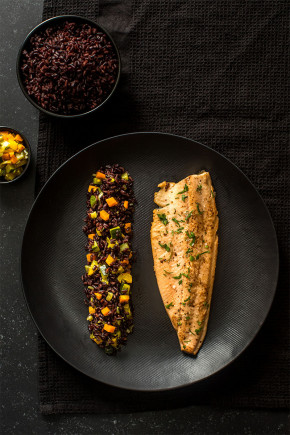 Black rice with vegetables and trout